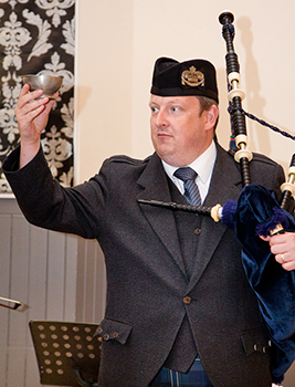 Donald MacKenzie offers the Quaich during a wedding reception, thus bringing a further good luck blessing on the couple.